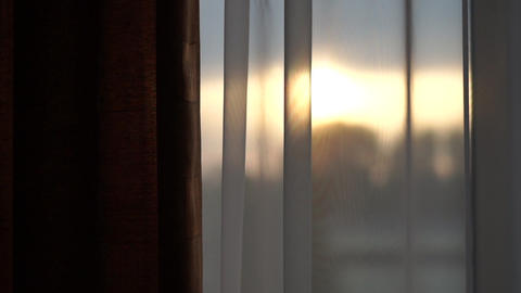 Sunset outside the window on which white curtains - slow motion Live Action