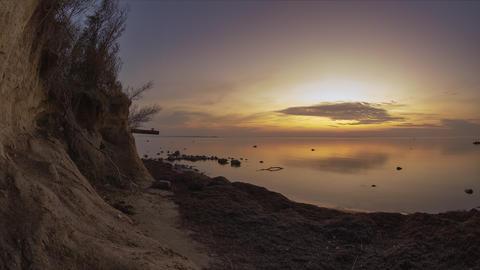 Sunset Over Calm Sea and Sandy Beach Timelapse Live Action