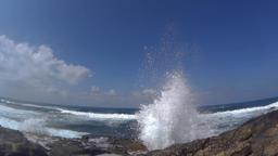 Powerful waves splashing high at the shore, half speed Footage