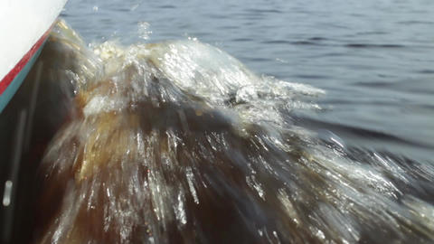 wave at side view of a motor boat Live Action