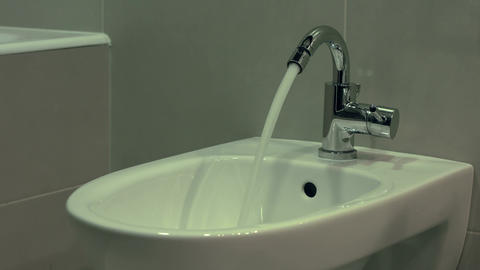 Chrome plated faucet and bidet in the bathroom Footage