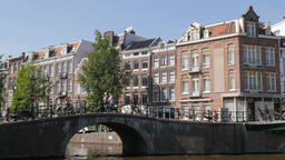 Canal houses with bridge and bicycles,Amsterdam,Netherlands Footage