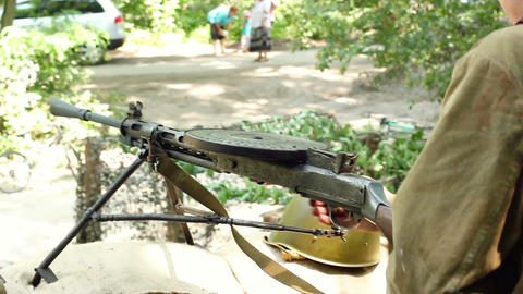 Soldiers make a shot from machine gun world war reconstruction Footage