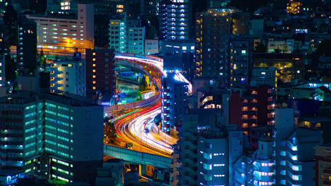 A night timelapse of highway at the urban city in Tokyo long shot tilt Live Action