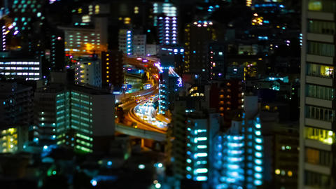 A night timelapse of highway at the urban city in Tokyo tiltshift zoom Live Action