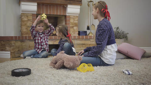 Portrait of cheerful Caucasian boy putting toy crown on head entertaining elder Live Action