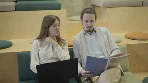 Portrait of creative male and female office workers discussing project in open Live Action