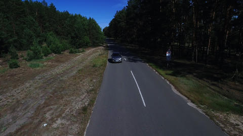 Drone footage car riding on trip at forest. Silver jeep riding at forest road Live Action