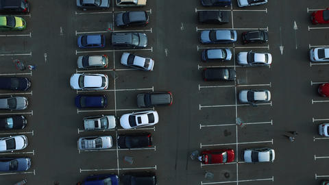 Drone footage cars parking at congested parking lots. people walking parking Live Action