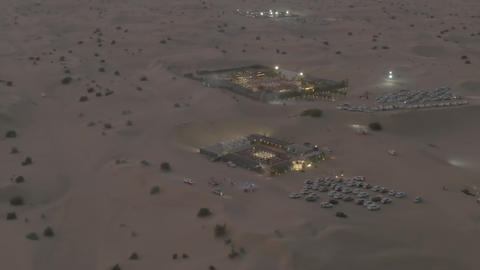 Aerial shot of recreational desert camps in the evening, United Arab Emirates Live Action