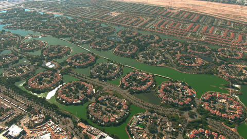 Aerial view of luxury Jumeirah Islands and Jumeirah Park communities in Dubai Live Action