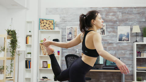 Fit and super flexible woman standing in yoga pose Live Action