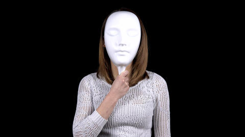 A young woman takes off the mask and shows emotions of anger on her face. Woman Live Action