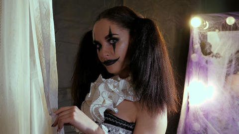Portrait of a woman. A clown with a smile in corset with a white collar on the Live Action