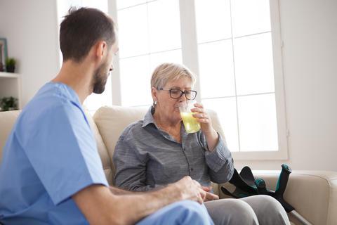 Senior woman in nursing home taking her pills Photo