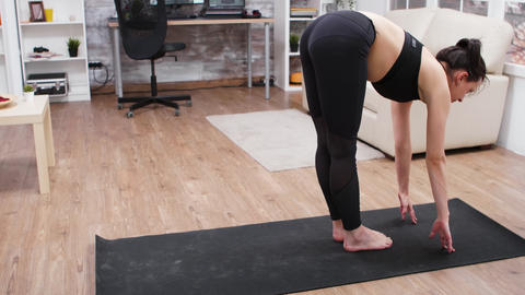 Sporty girl doing a yoga exercise at home GIF