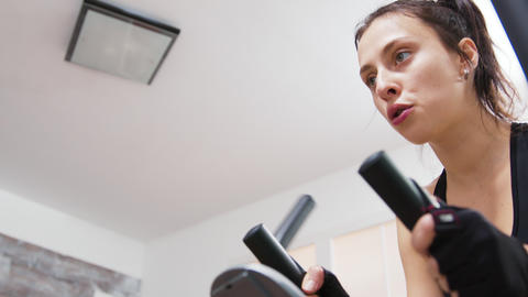 Young woman at home breathing heavily while doing a workout GIF