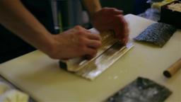 Makizushi preparation HD video. Sushi chef makes nori rolls. Japanese cuisine Footage