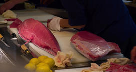 Chef cutting big bluefin tuna fish 4k video. sushi restaurant. Japanese cuisine Footage