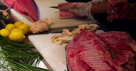 Chefs hands cutting scraping tuna fish filet 4k close up video sushi restaurant  Footage