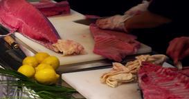 Chefs prepares bluefin tuna fish spoon put to plate 4k video sushi restaurant Footage