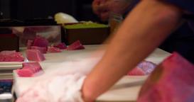 Raw tuna fish filet in sushi restaurant kitchen 4k video: chefs cook preparing Footage
