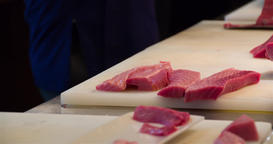 Sushi preparing cutting raw tuna 4k bokeh close up video. Japanese restaurant Footage
