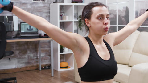Young woman doing a full body workout at home GIF