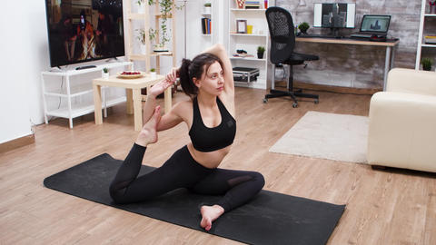 Young woman working on her posture at home GIF