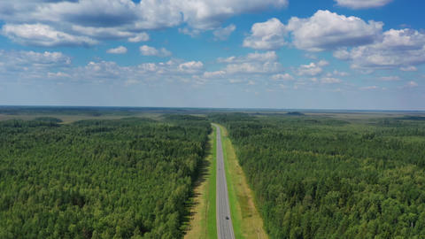 Aerial top view of country road in forest Live Action