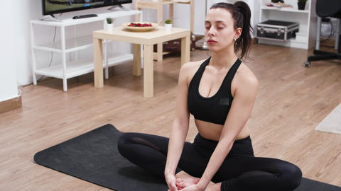 Caucasian relaxed young woman practicing yoga GIF