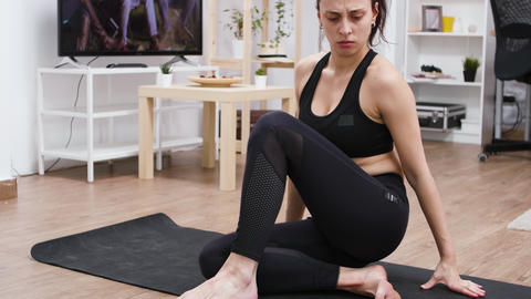 Sporty caucasian young woman learning yoga GIF