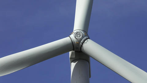 Windmill or wind turbine on wind farm in rotation Live Action