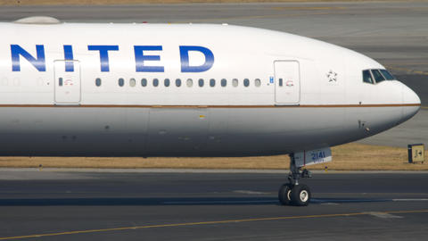 Boeing 777 United Airlines on International Airport of Hong Kong GIF