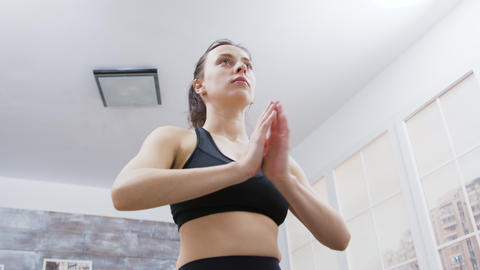 Attractive brunette doing her daily yoga meditation Live Action