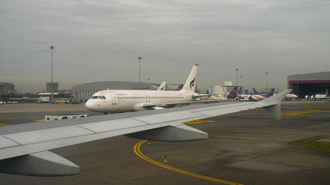 Airplane taxiing in Suvarnabhumi airport, Bangkok Live Action