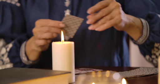 Close-up of lighting candle standing on the table as…, Live Action