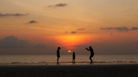 Silhouettes of a happy family in the sunset light Live Action