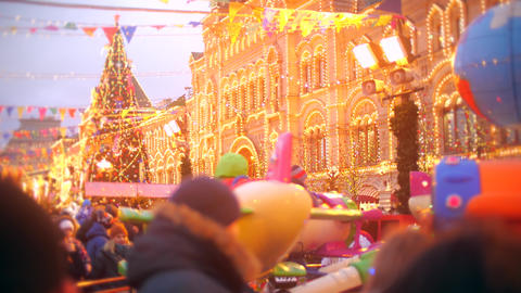 Unknown adults and kids visit New Year and Christmas Bazaar on the Red Square in Live Action