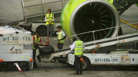 Uploading luggage onboard the aircraft GIF