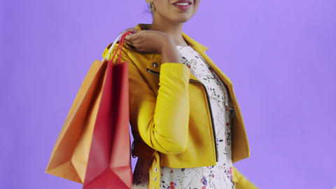 Portrait of african american woman with shopping bags and... Stock Video Footage