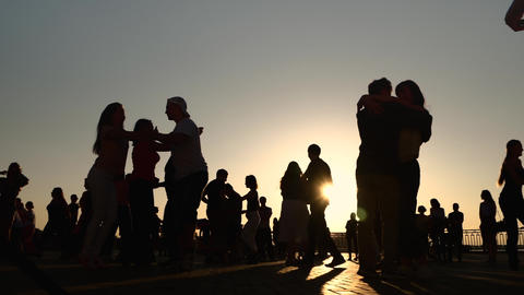 People silhouettes learning how to dance on city at sunset - super slow motion Live Action