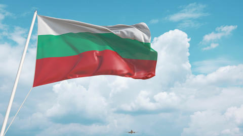 Commercial airplane landing behind the Bulgarian flag. Tourism in Bulgaria Live Action