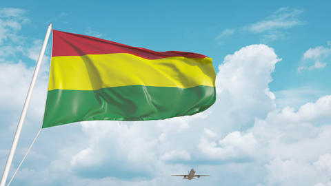 Airliner approaches the Bolivian flag. Tourism in Bolivia Live Action