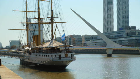 Sarmiento Frigate and Womans Bridge on background in Buenos Aires Live Action