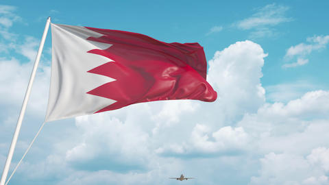 Commercial airplane landing behind the Bahraini flag. Tourism in Bahrain Live Action