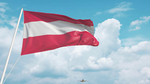 Commercial airplane landing behind the Austrian flag. Tourism in Austria Live Action
