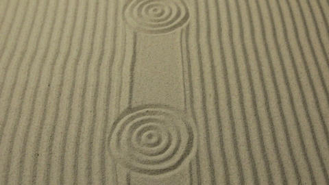 Circles and lines on the sand. Panorama. Texture of sand. Simple spiritual Live Action