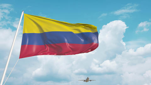Commercial airplane landing behind the Colombian national flag. Tourism in Live Action