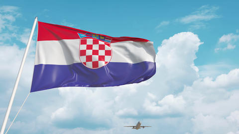 Airliner approaches the Croatian national flag. Tourism in Croatia Live Action